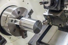 The CNC lathe machine clamping steel rod . High precision CNC machining concept stock photos