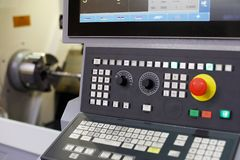 CNC lathe machine with a control panel. Selective focus stock photography
