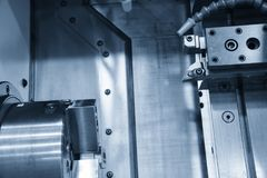The CNC lathe machine and the cutting tool stock images