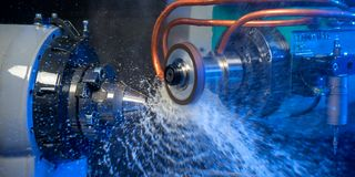 The CNC lathe machine. The hi-technology machining concept.
