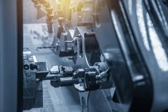 The CNC lathe machine operate with the robotic arm. Hi-technology manufacturing process royalty free stock photography