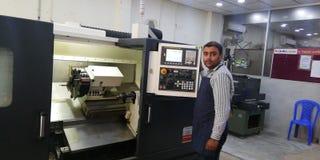CNC Lathe Machine Operation Fanuc Controlled. CNC Machine Operation in Bangladesh Stock Images