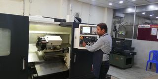 CNC Lathe Machine Operation Fanuc Controlled royalty free stock photos