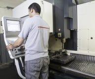 CNC lathe machine. Operator manufacturing metallic parts by CNC lathe machine stock photography