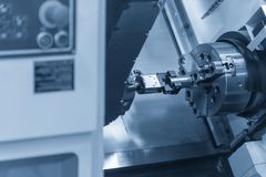 The CNC lathe machine setting the work pieces. By robot arm.Industrial 4.0 manufacturing concept Stock Photos