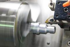 CNC lathe machine Turning machine. Cutting the metal thread part by lathe cutter .Hi-precision CNC machining concept stock photography