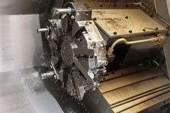 The CNC lathe machine. Turning machine for drilling with the drill tool and center drill tool .The hi-technology machining. CNC. Milling machine royalty free stock photography
