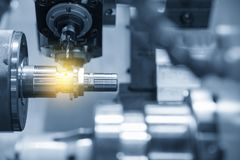 The CNC lathe machine or Turning machine. Drilling the metal rod with the drill tool and center drill tool .The hi-technology machining concept stock image