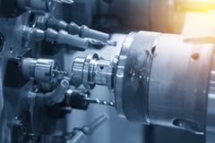 CNC lathe machine or Turning machine. Drilling the steel rod .Hi technology manufacturing process stock image