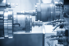 CNC lathe machine Turning machine. Cutting the aluminium thread shaft.Hi-precision CNC machining concept stock photo