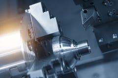 CNC lathe machine Turning machine. Cutting the metal cone shape part .Hi-precision CNC machining concept stock images