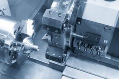 CNC lathe machine Turning machine. Cutting the metal thread part .Hi-precision CNC machining concept stock photos