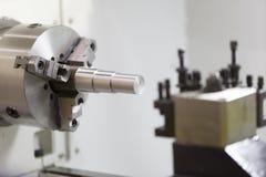 CNC lathe machining turing automotive parts Royalty Free Stock Photos