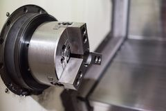 CNC Lathe in manufacturing process stock photo