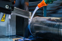 CNC lathe for metal band saw sawing round billet. Royalty Free Stock Photo