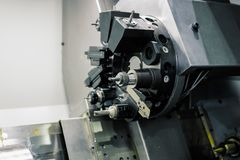 Cnc lathe tool turret. Rotating head for tool change royalty free stock photo