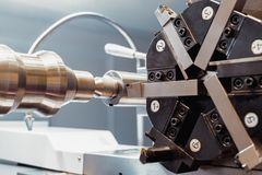 Cnc lathe tool turret. Rotating head for tool change stock photography
