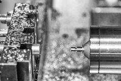 CNC lathe with the work pieces. In black and white scene Stock Photography