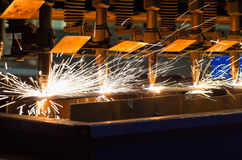CNC LPG many torches cutting metal Royalty Free Stock Photos