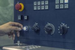 CNC Machine control panel with hand the press royalty free stock photography