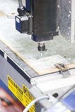 CNC  machine cutting acrylic plate Stock Images