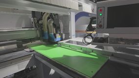 Cnc machine at the exhibition of hardware technology. CNC machine tool at work at the exhibition.  stock footage