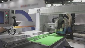 Cnc machine at the exhibition of hardware technology. CNC machine tool at work at the exhibition.  stock video footage
