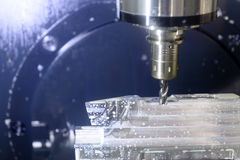 The CNC machine while prepare cutting sample work piece. Royalty Free Stock Image