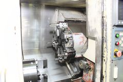 Cnc machine tools in the work Royalty Free Stock Photos