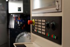 CNC machining center with a control panel. In the foreground. Selective focus royalty free stock photo