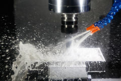 Cnc machining center milling with coolant Stock Images