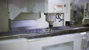 CNC machining station at work. Milling, threading, drilling. Industry, industrial concept. stock video