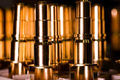 CNC made ready golden pipes details for water, oil and aerospace Royalty Free Stock Photos