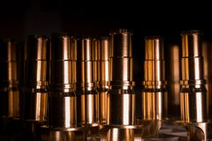 CNC made ready golden pipes details for water, oil and aerospace Stock Photography
