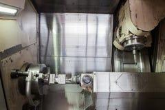 Lathe processes metal workpiece royalty free stock photo