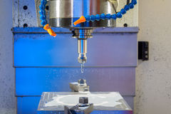 Cnc metal working machine with cutter tool during metal detail milling Stock Images