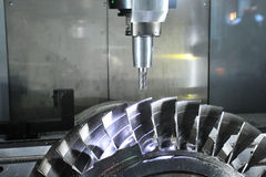 CNC-milling. A photo of CNC-milling of a motor block Royalty Free Stock Photo