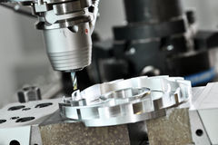 CNC milling cutting process. metalwork machining by mill cutter. Milling cutting metalworking process. Precision industrial CNC machining of metal detail by mill Royalty Free Stock Images