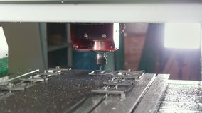 CNC milling or drilling machine - slider shot. Close up stock footage