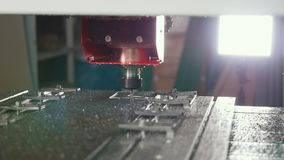 CNC milling or drilling machine - slider shot, slow-motion. Close up stock video