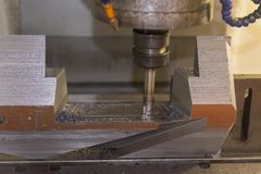 The CNC milling machine. Cutting the mold part stock photos