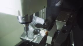 The CNC milling machine cutting the aluminium automotive part with the solid. Modern manufacturing process