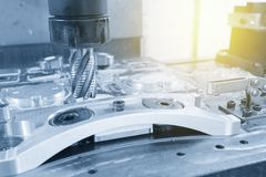 The CNC milling machine cutting the automotive part Stock Image