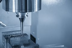 The CNC milling machine cutting the injection mold part. With the solid ball endmill tool.The precision  mold cutting Stock Photography