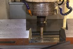 The CNC milling machine cutting the metal mold part stock image