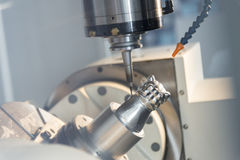 The CNC milling machine. Cutting the sample part with the small end-mill . Hi-precision CNC machining concept royalty free stock image