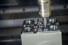 The CNC milling machine cutting the sample part. The tool length measurement on CNC machine Royalty Free Stock Photo