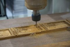 The CNC milling machine. Cutting the wooden royalty free stock photography