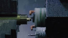 CNC milling machine makes some steel part stock video footage