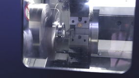CNC milling machine makes some steel part on factory stock video footage